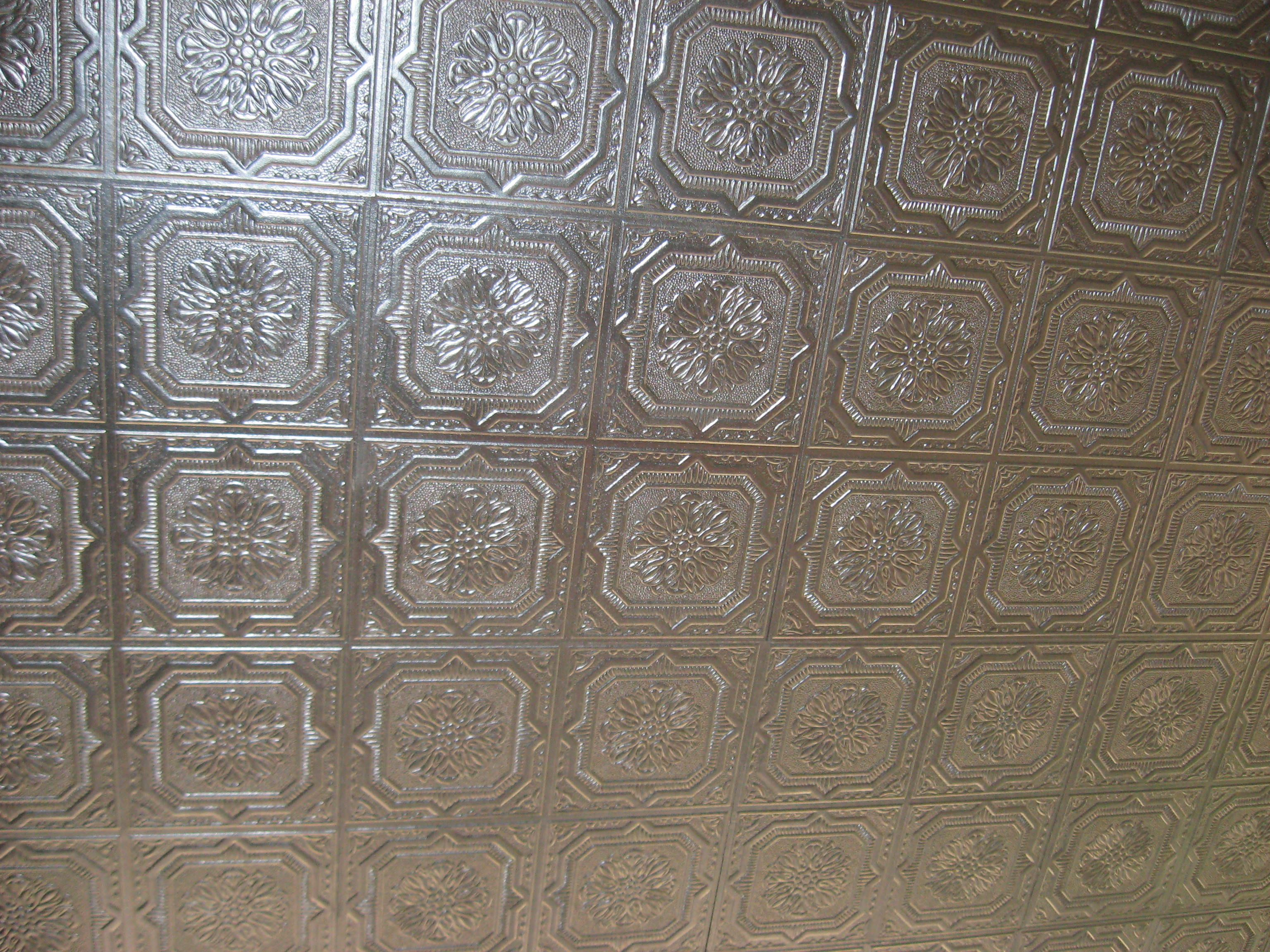 I made a faux tin ceiling in my sunroom after finding out how much i made a faux tin ceiling in my sunroom after finding out how much real tin ceilings cost painted inexpensive glue up ceiling tiles from lowes with dailygadgetfo Choice Image
