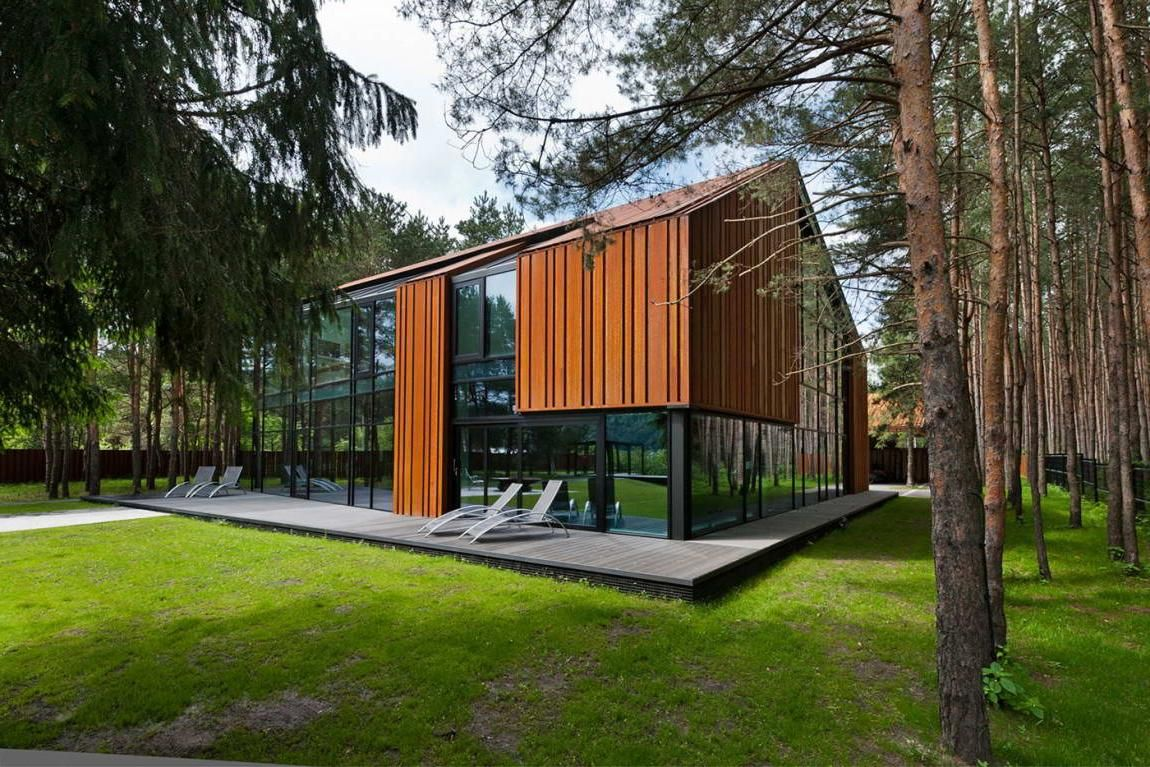 Small Modern House In Forest Design With Wooden Wall Decor Along