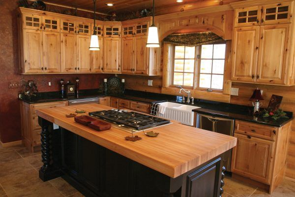 Beautiful Rustic Kitchen Cabinets Features Natural Finished Wooden Cabinet With Black Granite Countertop And White Pendant Light