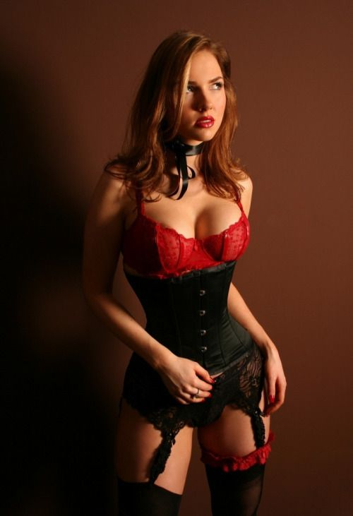 Hot redhead photo table corset