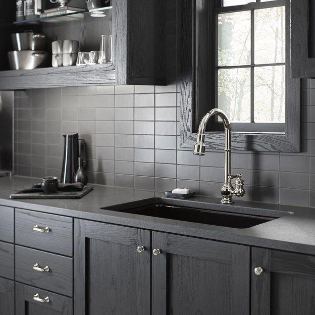 Savoy Ceramic Subway Tile Backsplash In Graphite In This Dark And Bold Kitchen With Dark Walnut