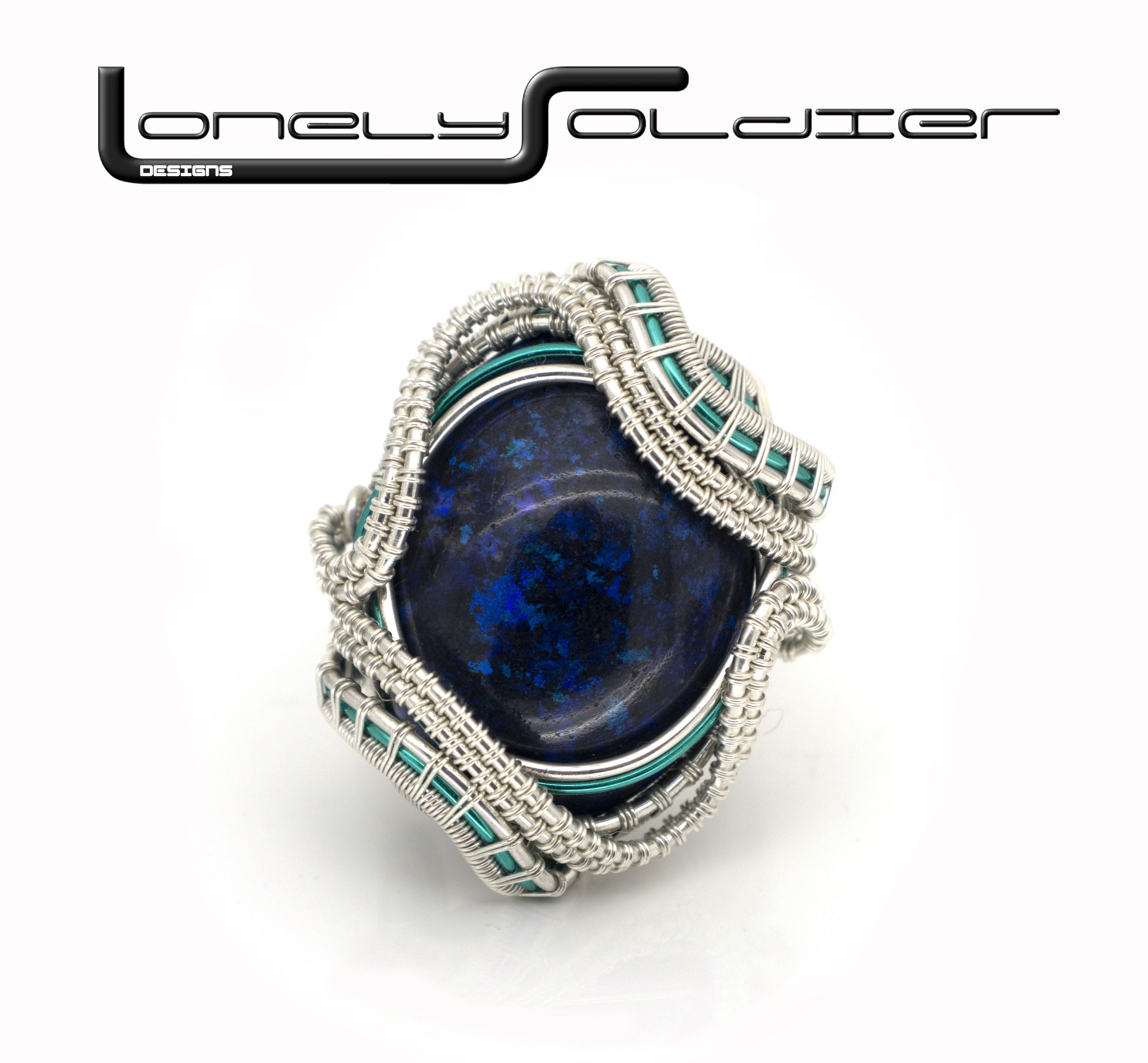 The Black Stone of Age\' Black Opal wrapped in Sterling silver wire ...