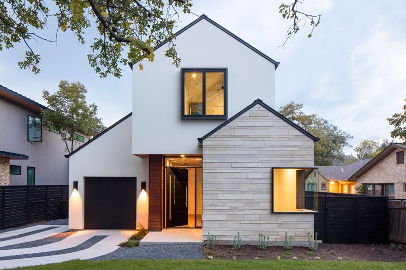 A contemporary house with peaked roofs arrives on this for Modern stucco house