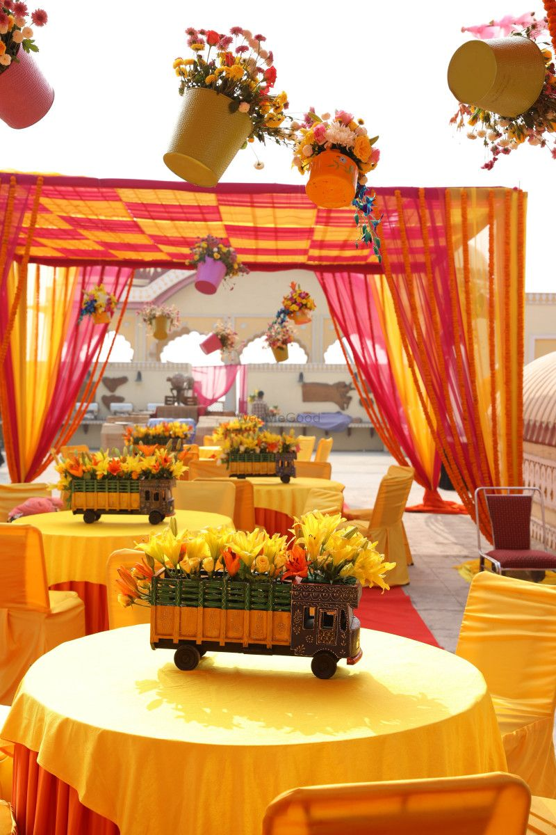 Hanging flower pots and decorated mini trucks as props for