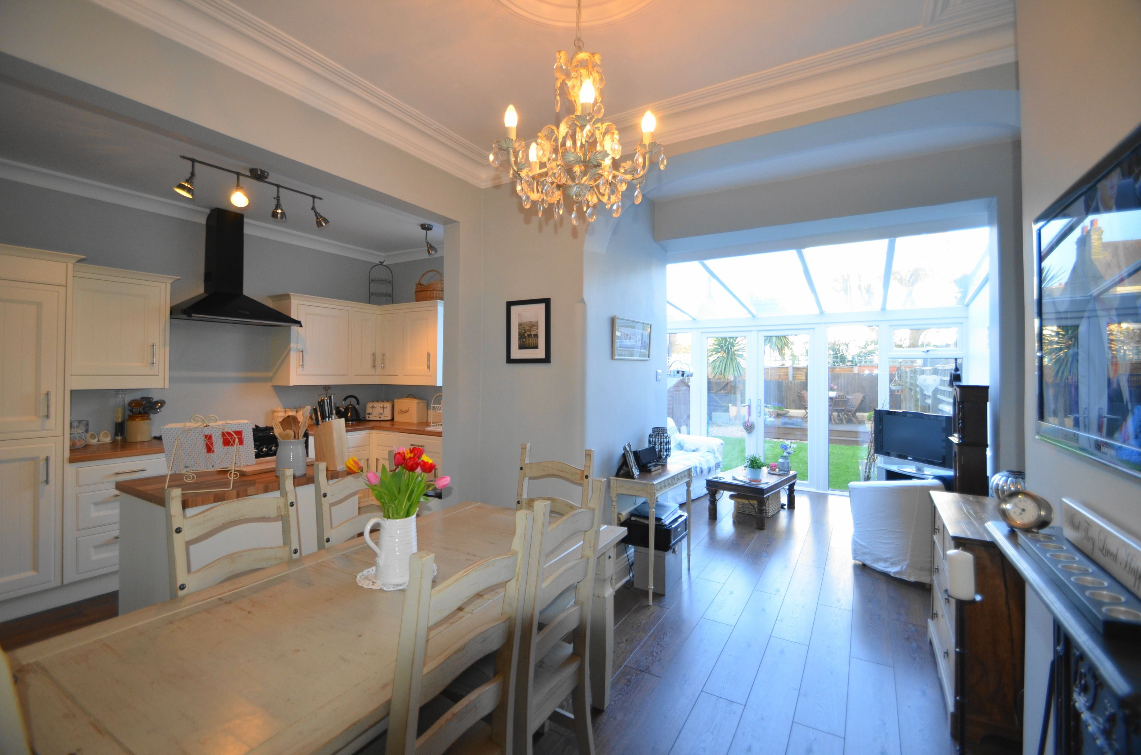 shabby chic style open plan, kitchen/diner/family room. features