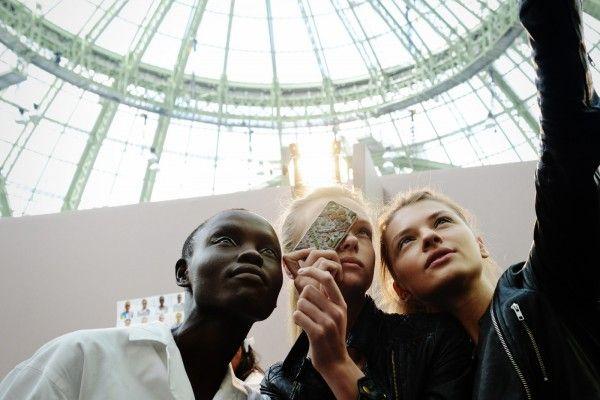 Models backstage at Issey Miyake in Paris Fashion Week