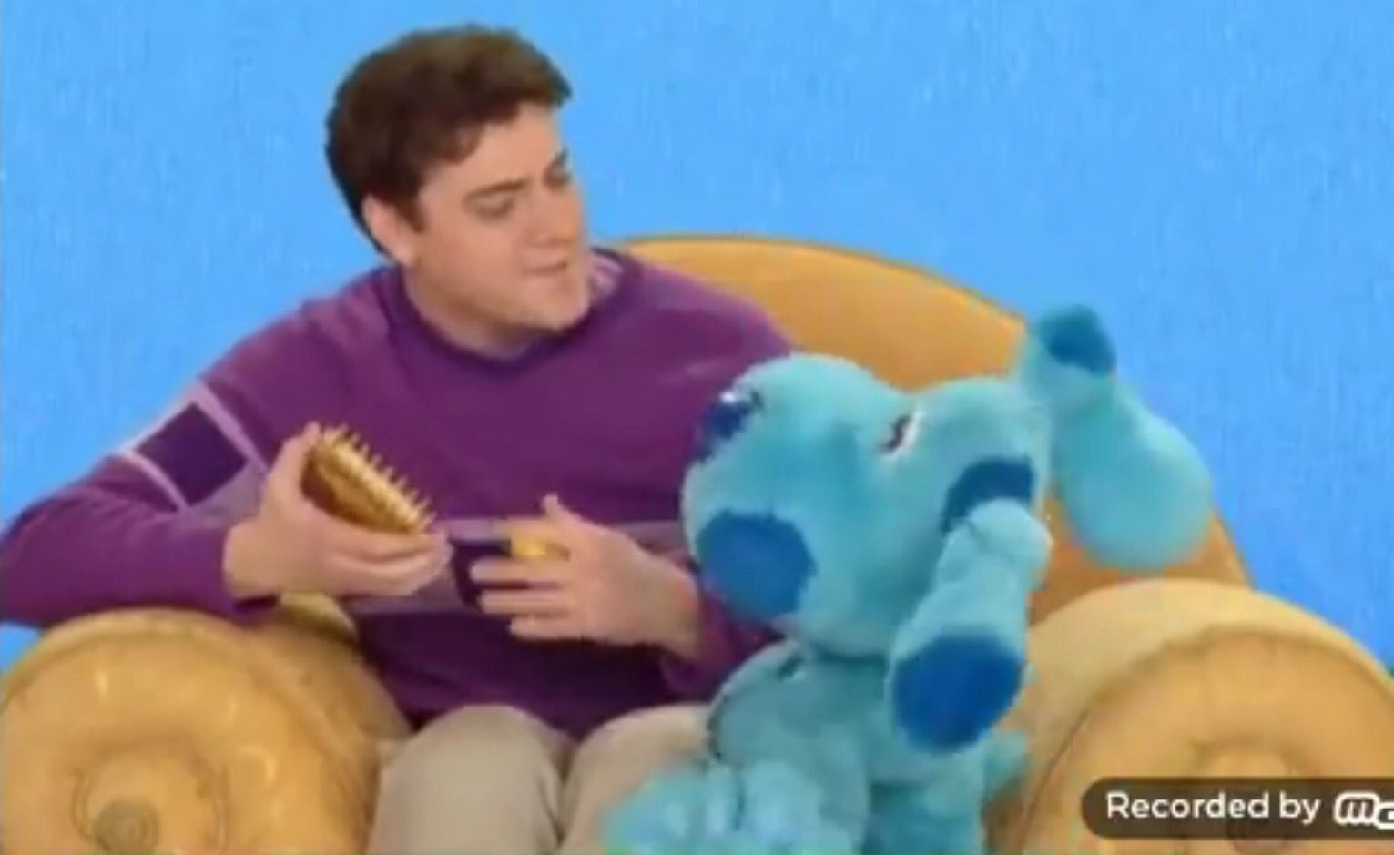 Joe and blue are sitting the golden thinking chair blue