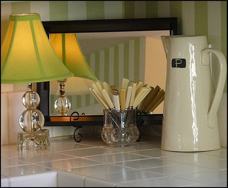 Vignette On Kitchen Counter Using Small Lamp Mirrored Tray Bakelite Knives In Holder And Large Cream Pitcher With Initial Chalkboard Frame
