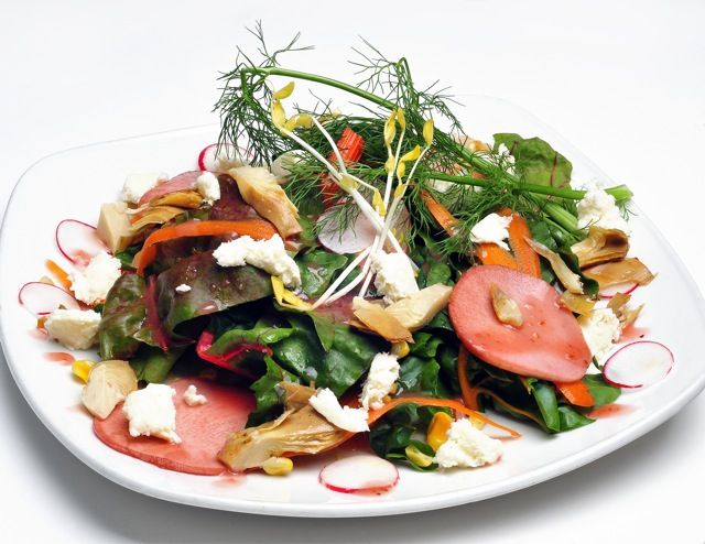 Leoci's Trattoria    farmers salad: mixed farmers greens with local shaved carrots and tomatoes topped with swiss dairy farm boiled egg and pea shoots drizzled with your choice of house-made raspberry jalapeno vinaigrette, lemon vinaigrette or caesar dressing