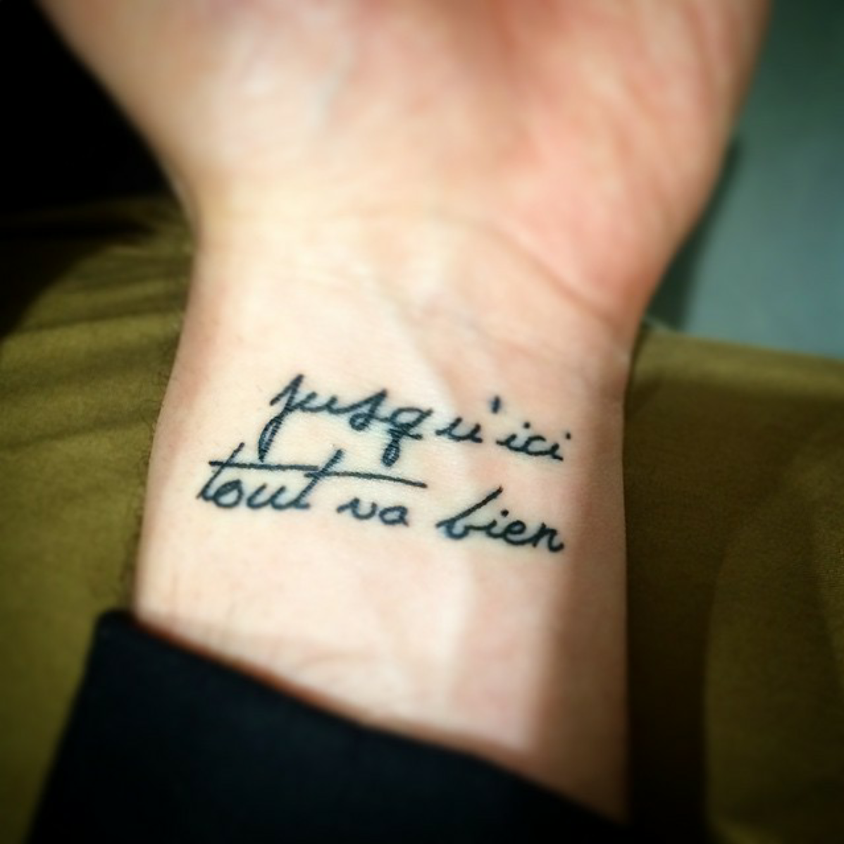 Little Wrist Tattoo Saying Jusquici Tout Va Bien French Quote