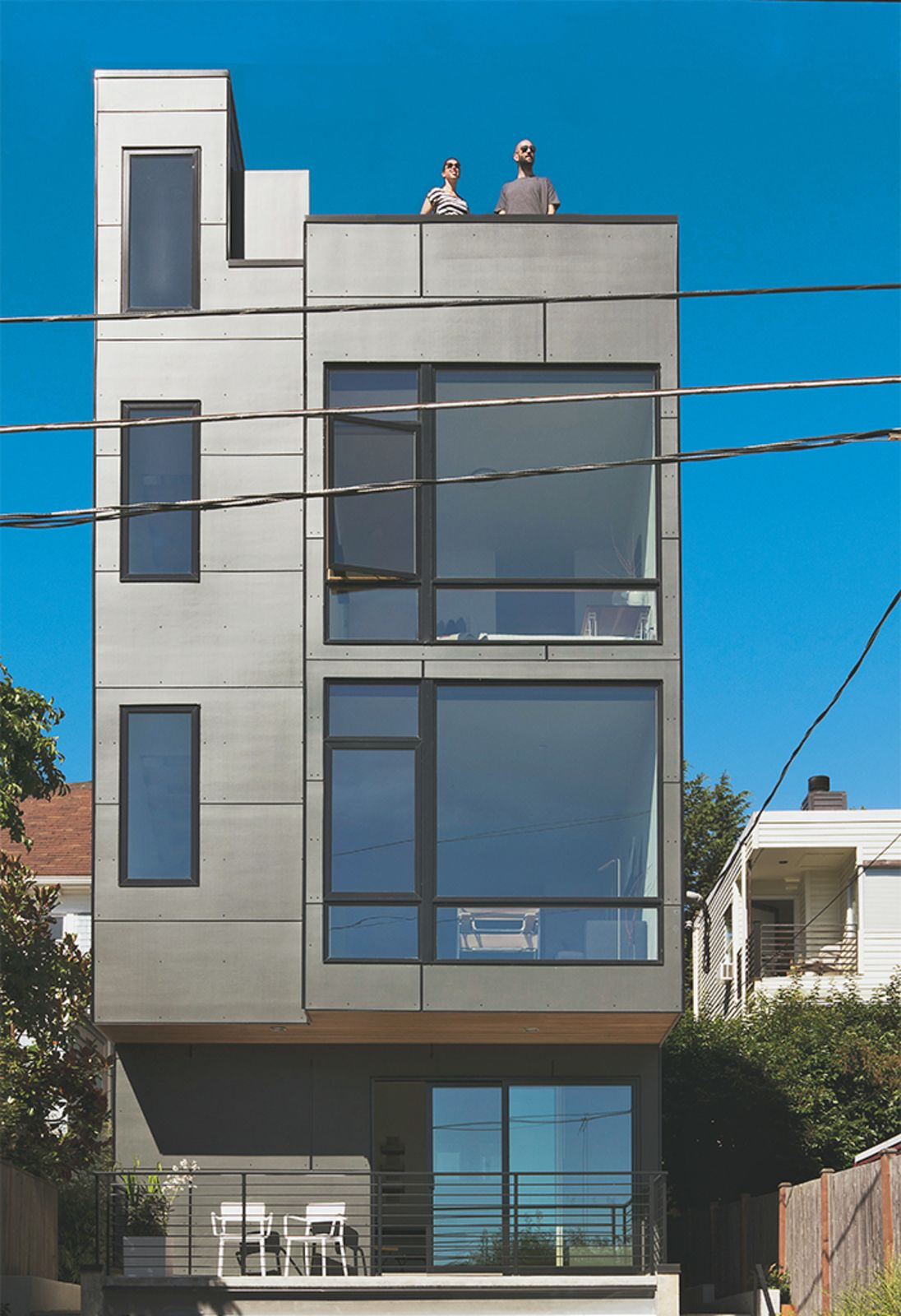 Prefinished cement fiberboard panels cover the rear facade.