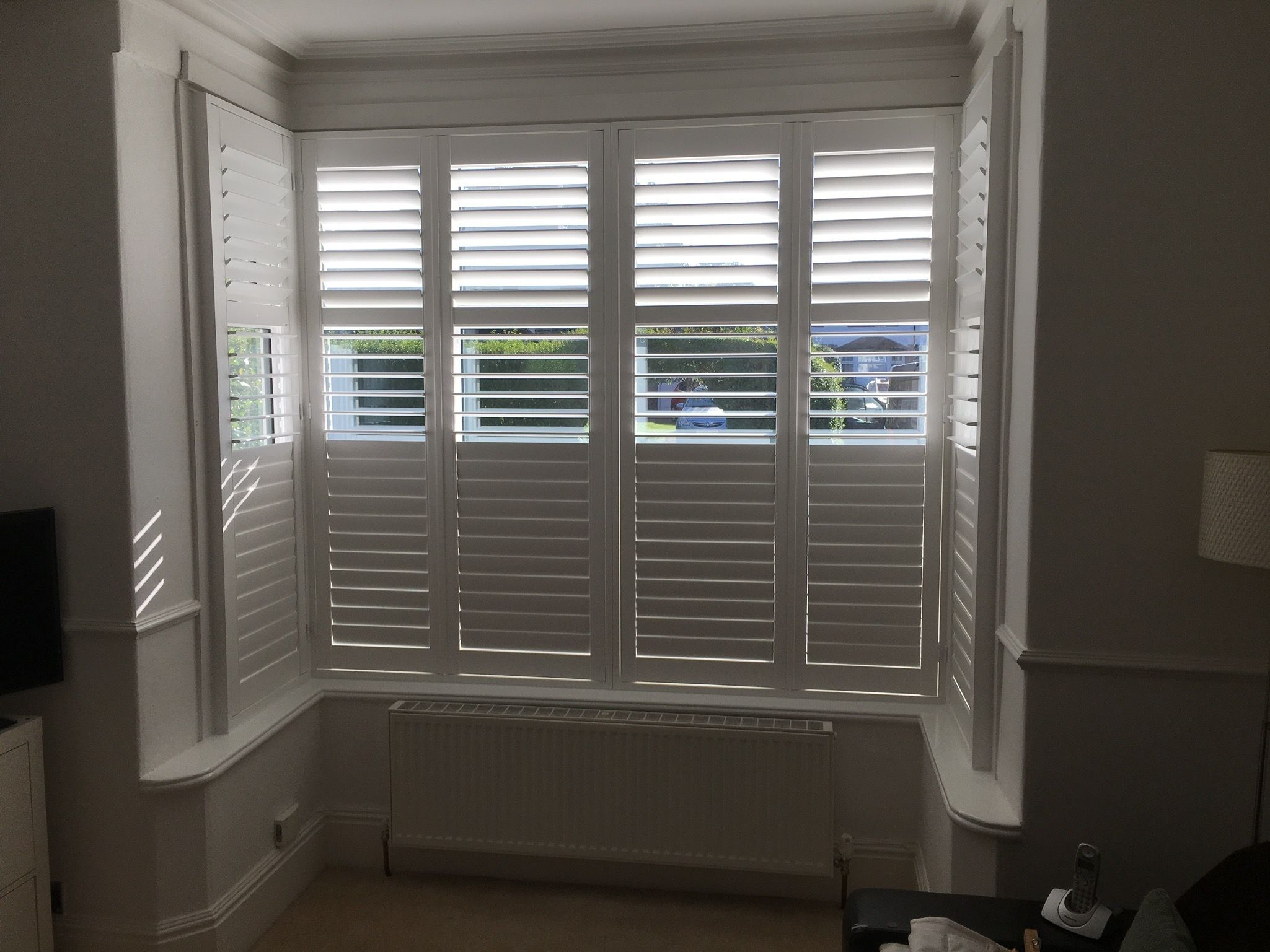 The second of the two box bay wooden window shutter