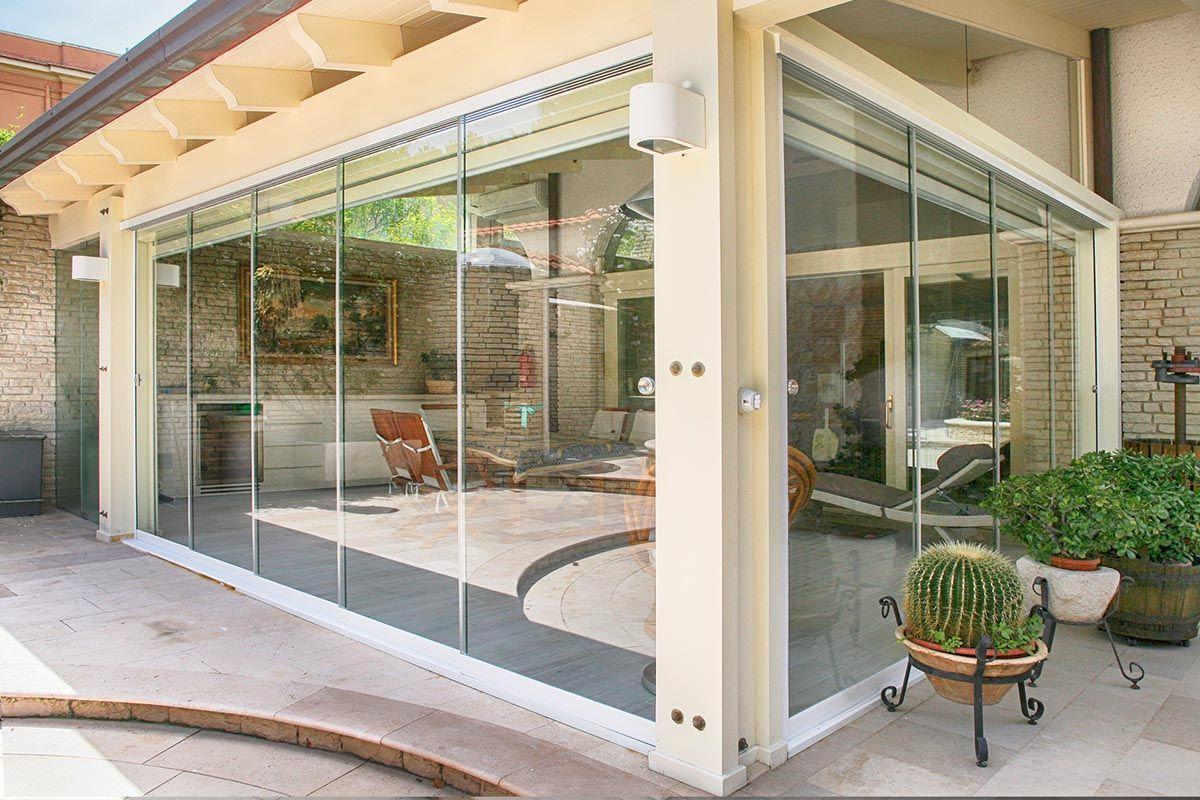 Veranda chiusa con vetrate panoramiche verande chiuse for Case con vetrate