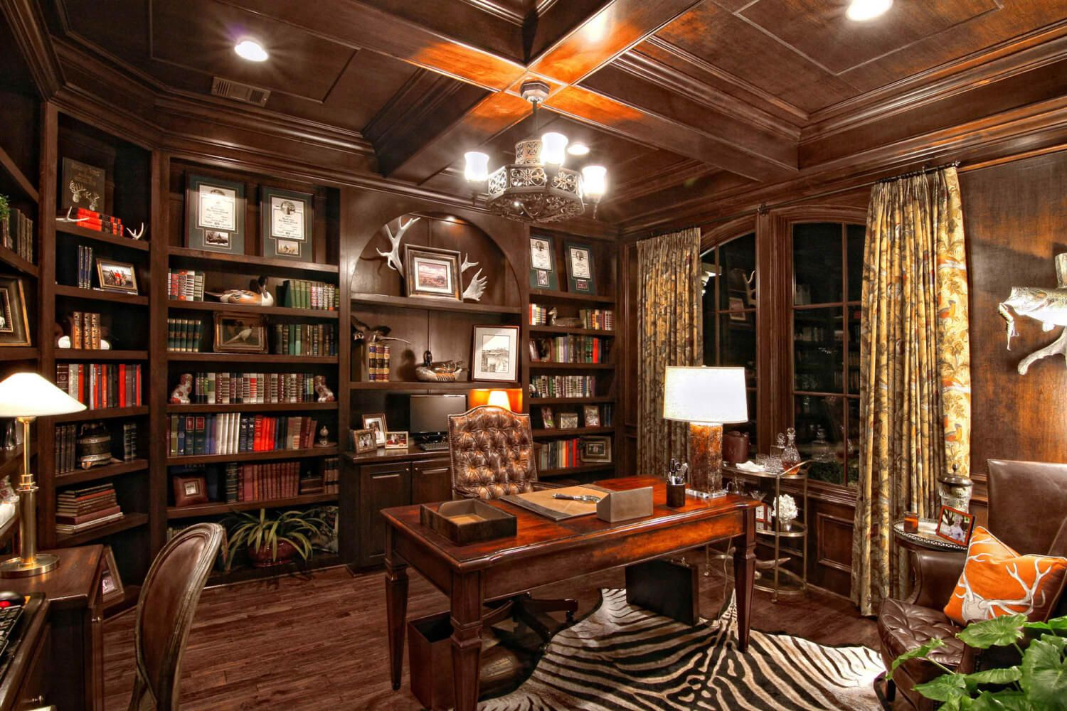 elegant home office accessories. Decoration, Gorgeous Chandelier Above Maple Desk And Brown Tufted Chair Beside Tidy Oak Bookshelves On Laminate Teak Flooring For Elegant Home Office With Accessories
