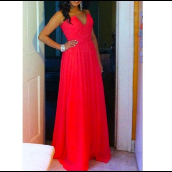 Strapless, Deep V plunge dress. Excellent Condition. Worn once to a Military Ball. Handmade to perfection. Watermelon-ish color. Fits a size 0-2. Length : 3ft 8 in from top of rib cage area!!! Dresses Strapless