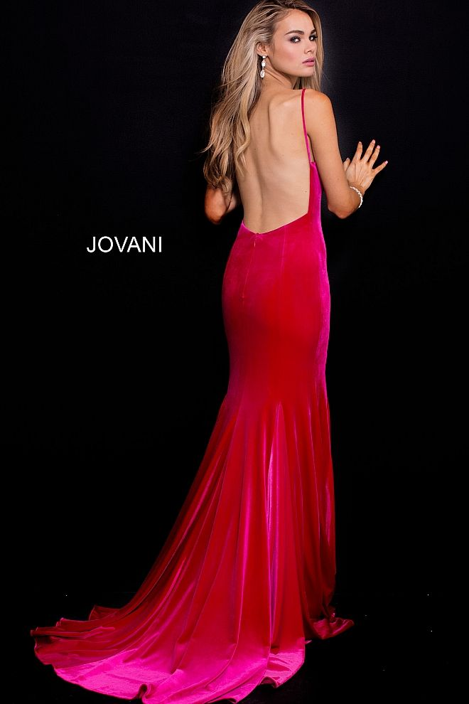 c5463f9e8cb5 Floor length form fitting hot pin velvet prom dress with sweeping train  features sleeveless bodice with spaghetti straps v neck and low back. # Jovani # ...