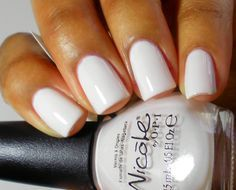 white nails on dark skin