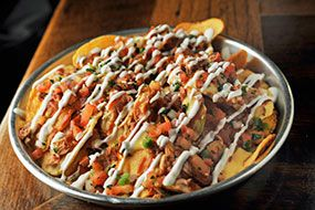 Drooling over these barbecue nachos. The best part? Our homemade potato chips.