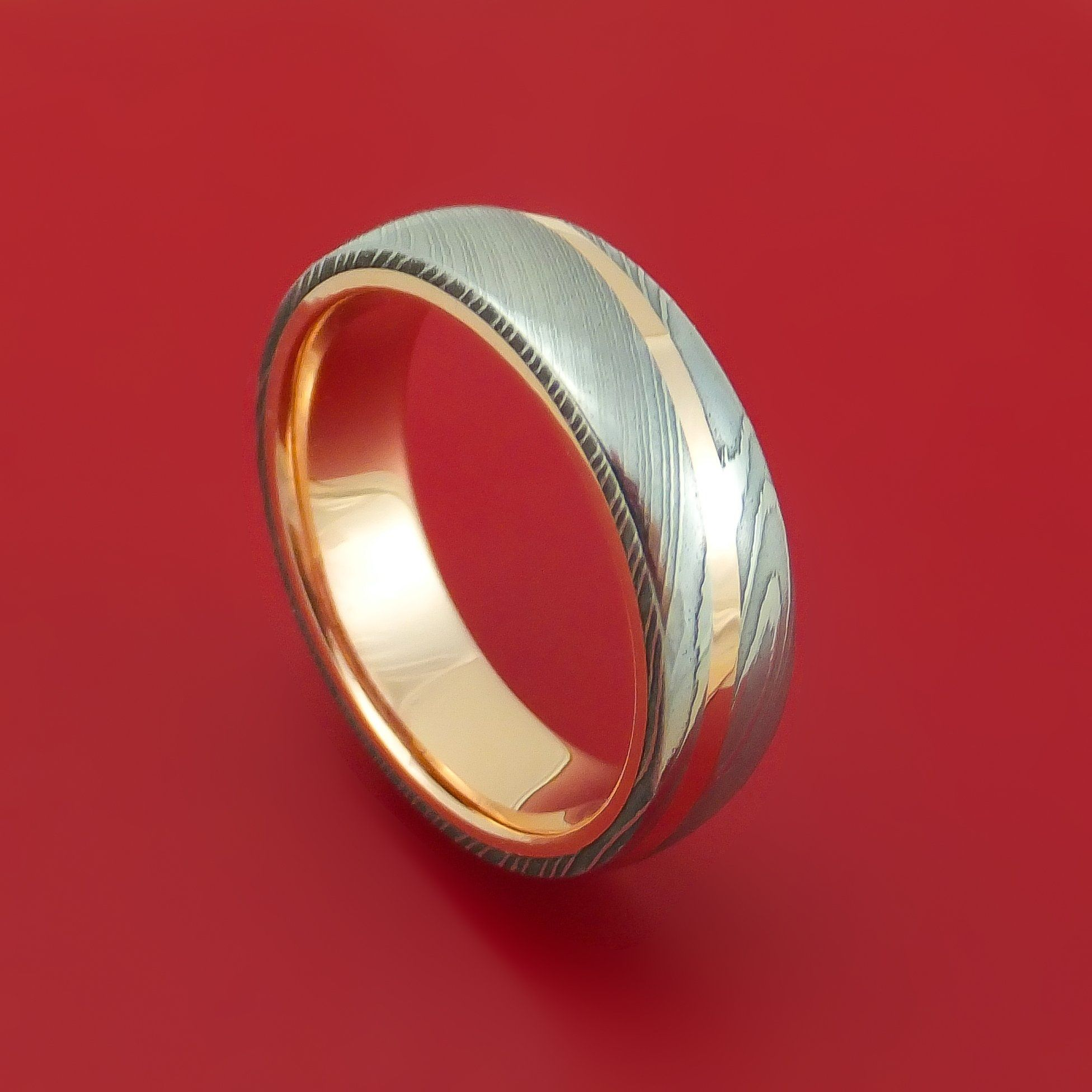 Damascus steel ring with 14k rose gold inlay and interior