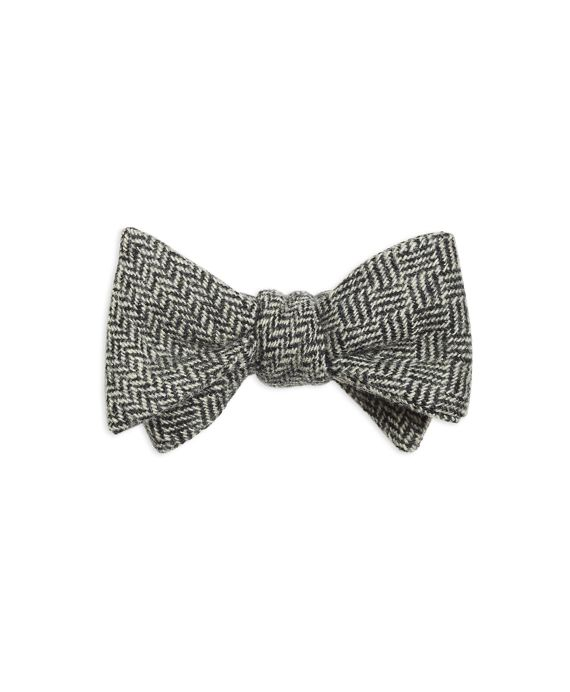 This bow tie is crafted from pure silk. Self-tie with either side facing out. Dry clean. Made in the USA.