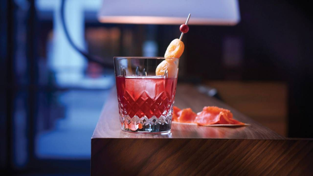 Rusty Cage Made With Whiskey Infused With Cranberries Honey Liquor Dried Apricot Four Seasons Toronto Dibar Food Honey Liquor Toronto Bars