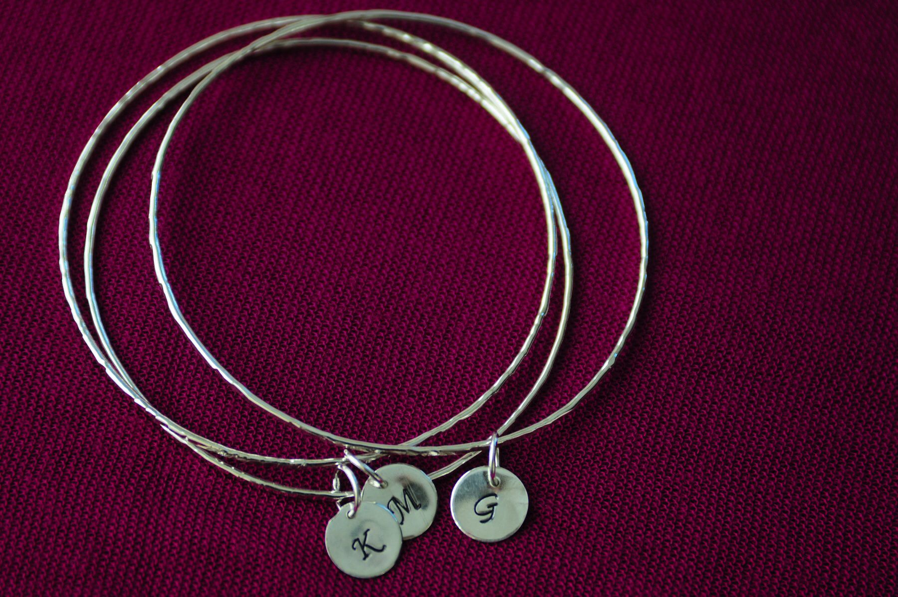 Sterling silver bangles with initial tag .www.odettealfaro.com