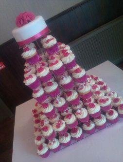 Love this cupcake wedding cake from http://www.sugarandspicecupcake.co.uk/