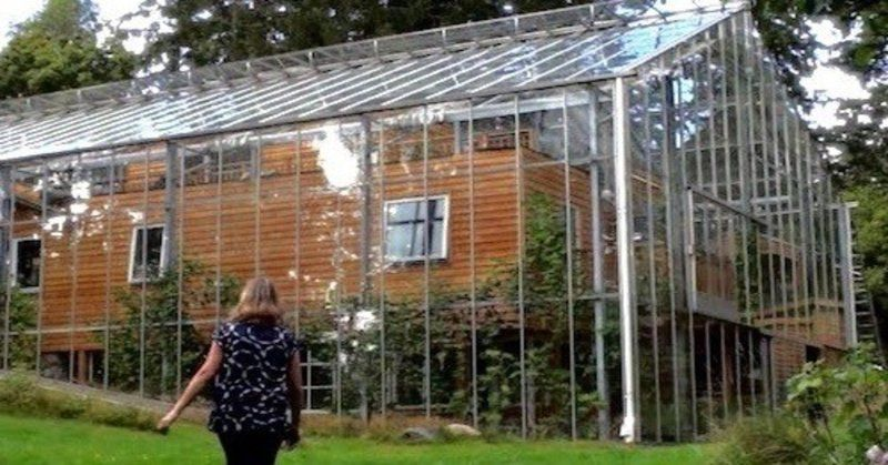 Couple Builds Greenhouse Around Home To Grow Food And Keep Warm Greenhouse House In Nature Build A Greenhouse