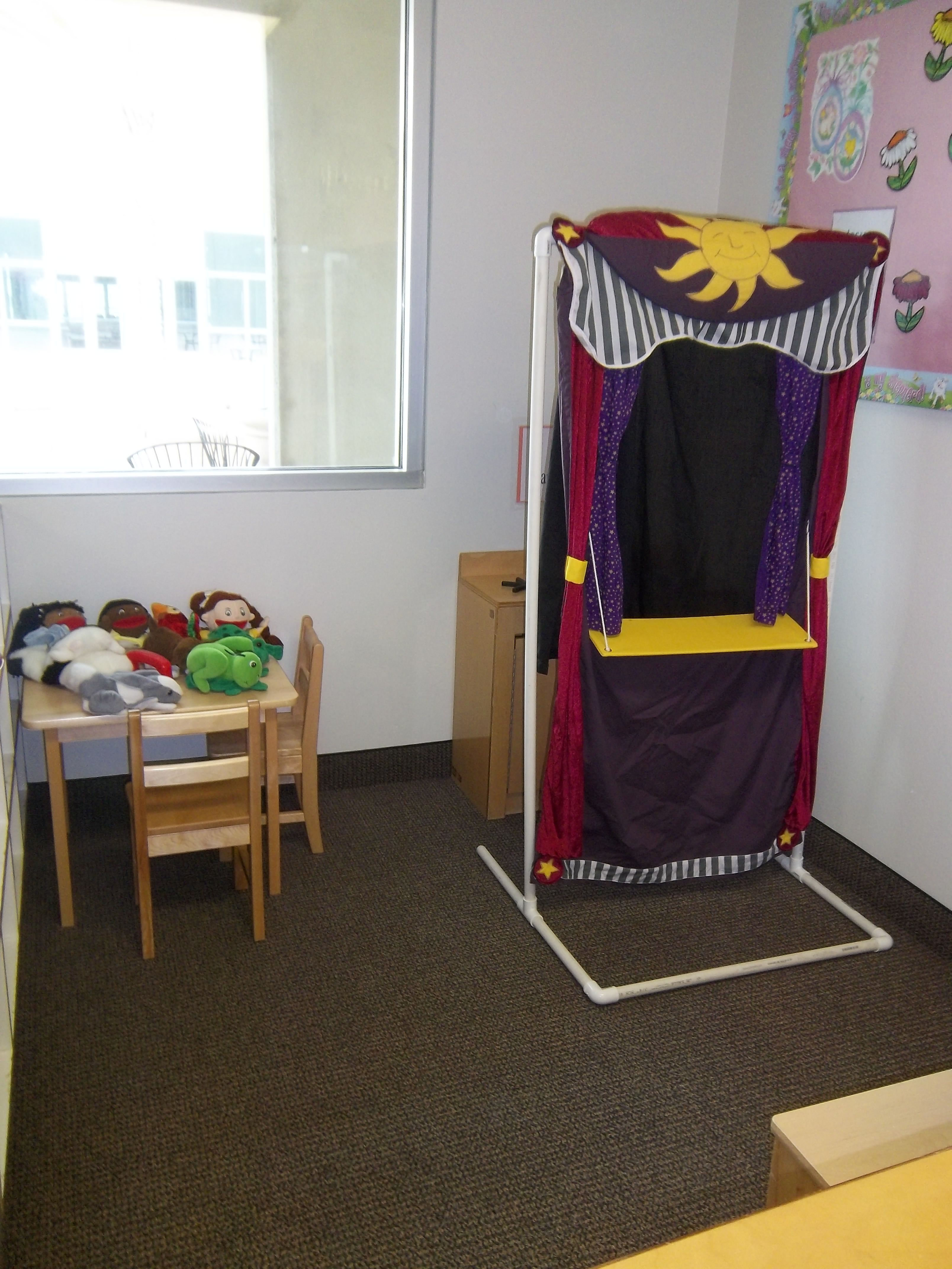 one of our dramatic play area ideas. it is a puppet show