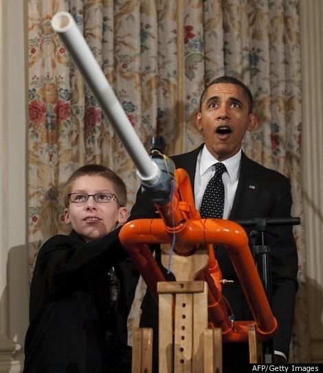 """At a White House science fair on Tuesday, Obama announced a plan to request funding for a new Education Department competition to support math and science teacher preparation programs.    With his science geek on full display, Obama also gleefully partook in a demonstration of the """"Extreme Marshmallow Cannon,"""" blasting pillowy bits of sugar at the drapes of the State Dining Room. It's safe to say the president was impressed by the contraption, built by 14-year-old Joey Hudy from Phoenix…"""