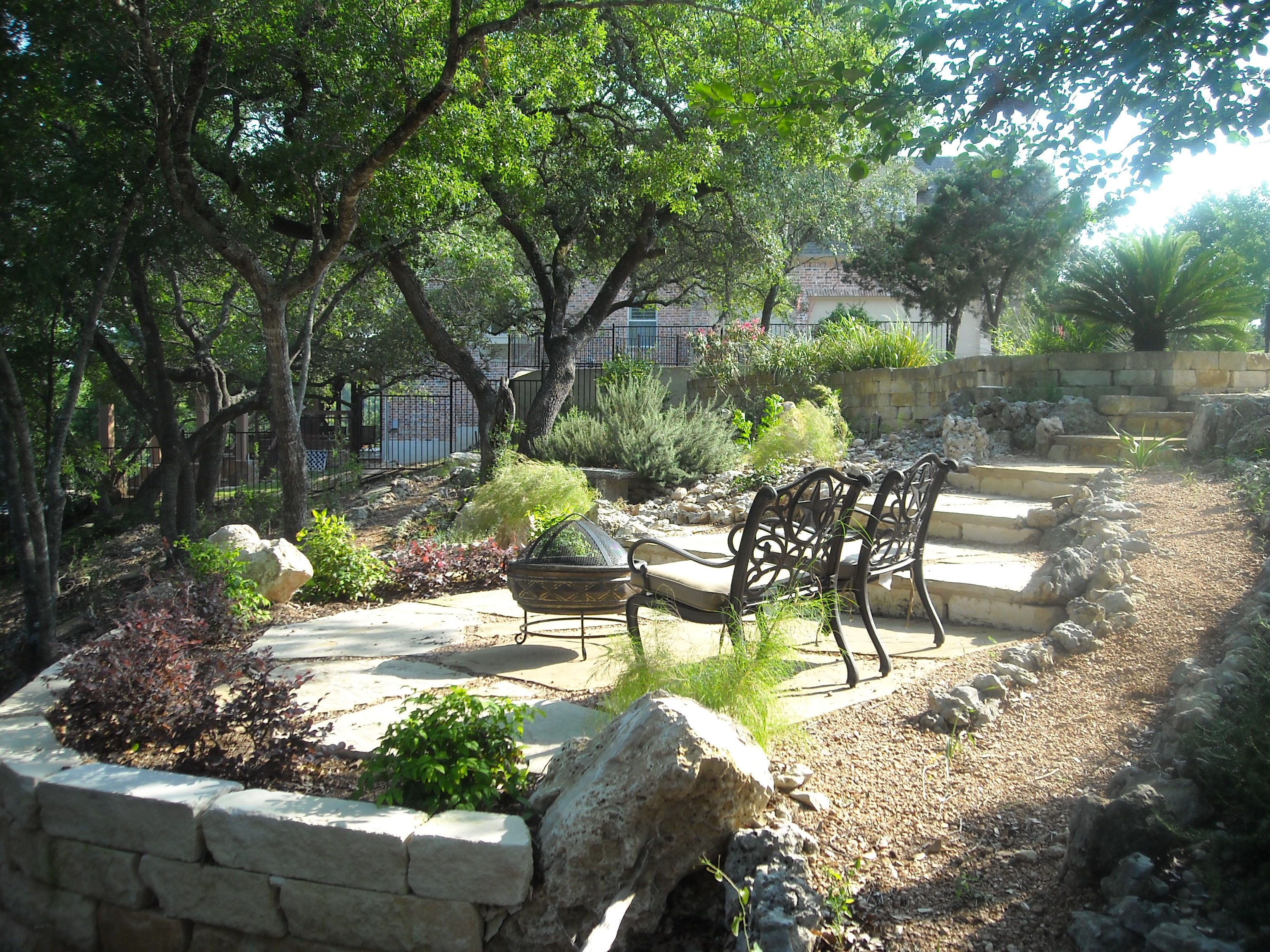 backyard landscape with multiple tiers and pathways for sitting