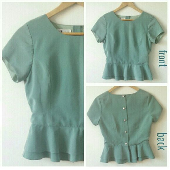 """Cute Peplum Top Peplum blouse with short sleeves. Sage green color, although it looks faded in the photo. The back of the blouse is closed with silver buttons the entire length. Great condition, no damage or signs of wear.   Front: 13"""" from neckline to top of peplum. Back: 14.5"""" from neckline to top of peplum. 5"""" peplum. 16"""" across bust between armpits. Imani Tops Blouses"""