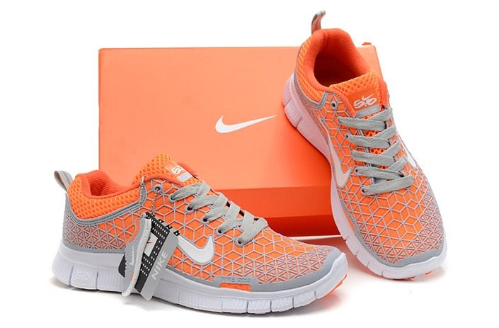7c7d8fc4d831 Tangerine orange and gray Nike women shoes.