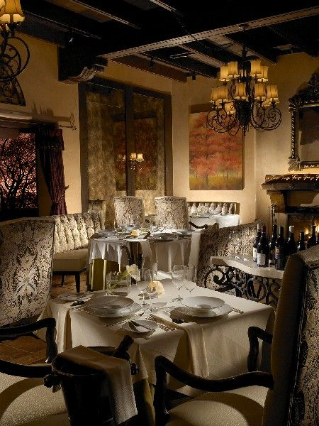 Fireside dining at the AAA Four Diamond Award-winning Fuego featuring Global Latin cuisine by Executive Chef Carmen Rodriguez, New Mexico Chef of the Year.
