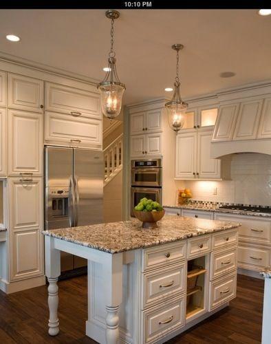 white kitchen but still feels warm.