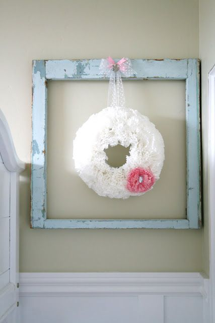 Love this wreath hanging from a chippy window frame