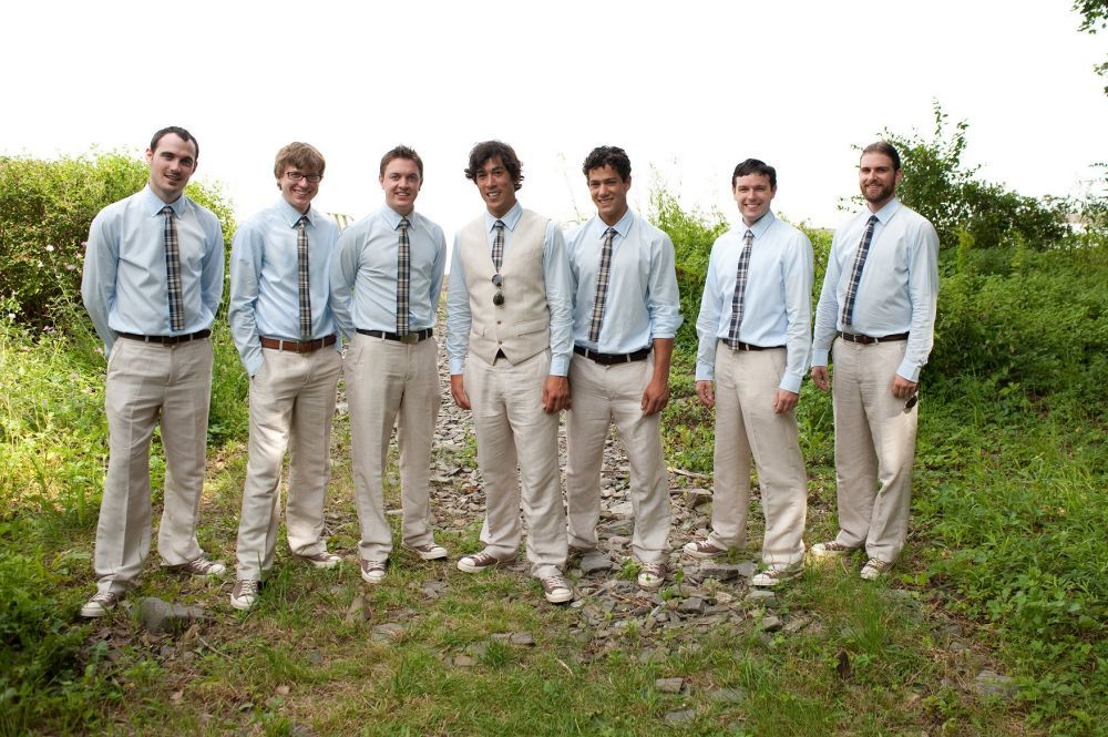 casual groomsmen attire | Casual groomsmen portrait by the mud ...
