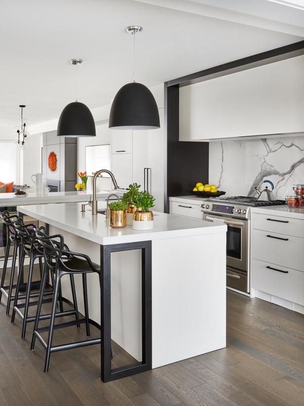 black and white kitchen with oversized pendants  hgtv's