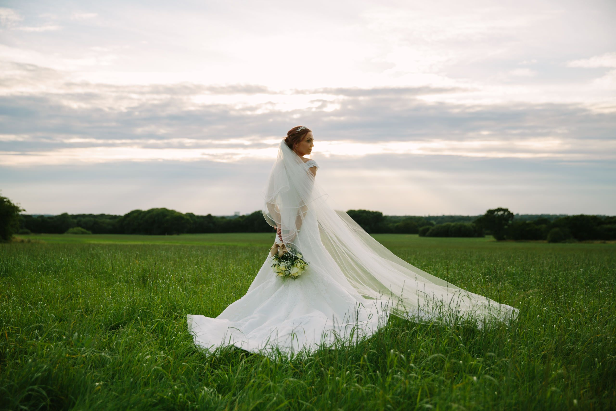 Sunlight steaming from the evening sky. #bride #sunset #portrait ...