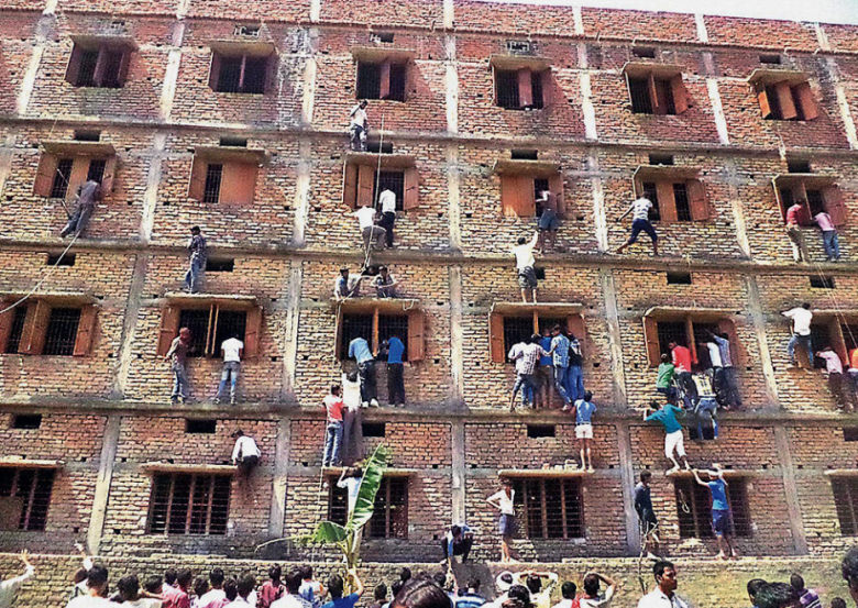 hundreds of parents scale school walls to help their kids cheat in exams