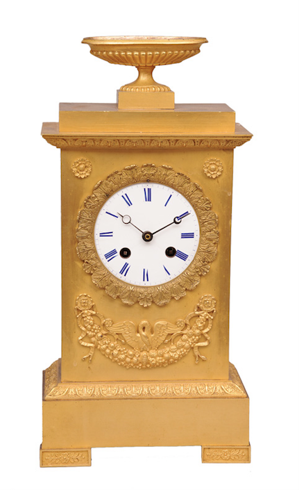 """France, early 19th cent. Bronze, fire gilded, partly polished and satinised. White enamel dial with blue rom. numerals, iron hands. Brass platine verso marked """"Medaille D""""Or Japy Freres"""", F.A. 6 415. Without glass. H. 35 cm, w. 17,5 cm, d. 8,5 cm."""