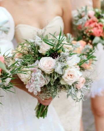 lush wedding bouquet of blush peonies, fresh herbs, parrot tulips, sweet peas and baby bud roses | photo: Steve Steinhardt