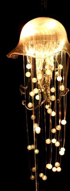 "Jellyfish chandelier. Imagine hundreds of these hanging from a ceiling in a large room, at different heights, forming a ""bloom"" (apparently, the name for a large group of them in one area!)"