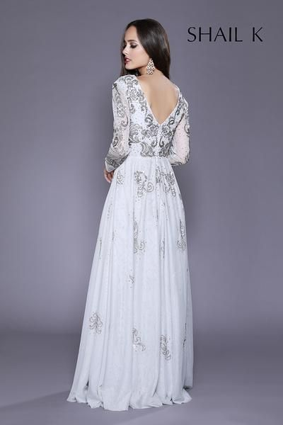 1f7fe6d3bfd5c This long sleeve low V- cut gown will have you looking good and feeling  fabulous, the fit to flirt style adds a modest touch coming in silver and  raspberry ...