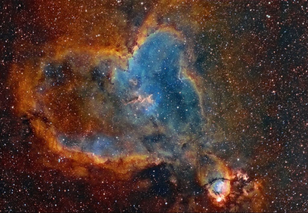 The Heart Nebula, IC 1805, Sh2-190, lies some 7500 light years away from Earth and is located in the Perseus Arm of the Galaxy in the constellation Cassiopeia. This is an emission nebula showing glowing gas and darker dust lanes. The nebula is formed by plasma of ionized hydrogen and free electrons. The very brightest part of this nebula (the knot at the right) is separately classified as NGC 896, because it was the first part of this nebula to be discovered.
