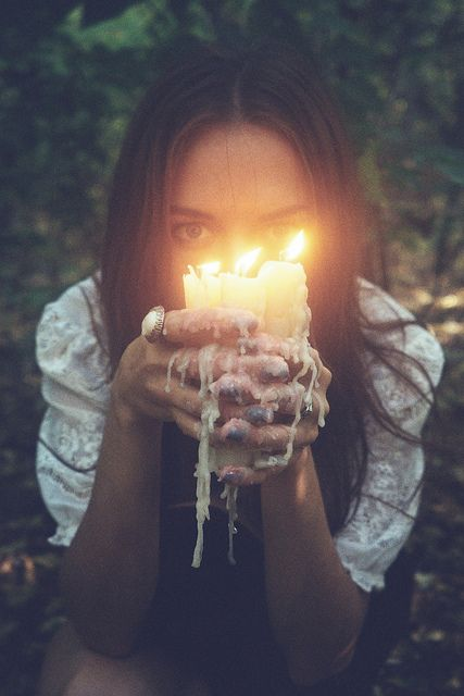 LOVE the dripping wax... I'd DEFINITELY focus on the face a little more.. but still have the candles like.. under the face.. this pic is too good to pass up sharing.