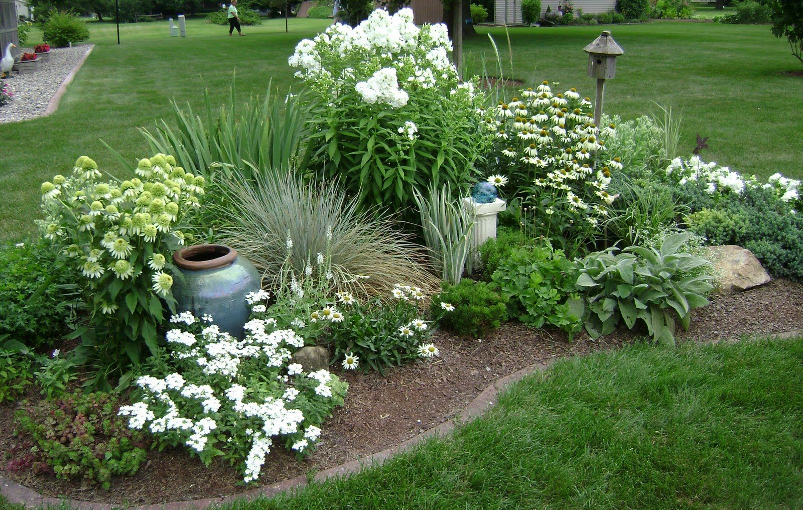 Two of the main whites--phlox and Coconut Lime Echinacea. Something like  this might work in the weird small round hill in our front ...
