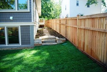 outside side of house landscaping idea with fenced in yard.
