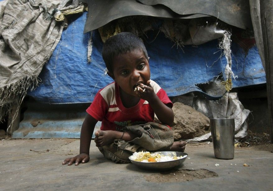 An+Indian+child+eats+mid-day+meals+organized+by+Government+of+Andhra+Pradesh+at+a+shanty+area+of+Hyderabad.+(AP)