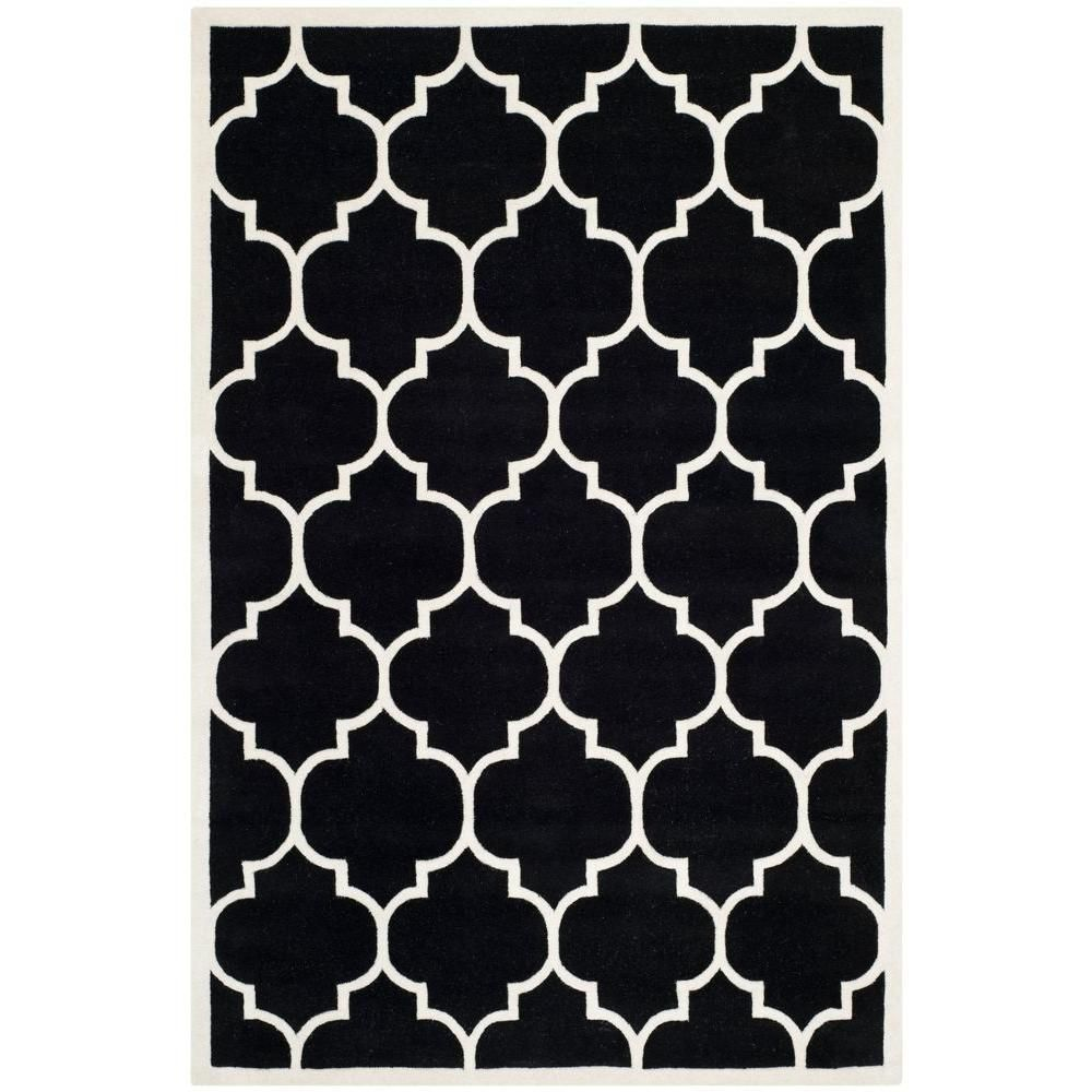 the safavieh chatham black ivory 6 ft x 9 ft area rug needs vacuum regularly and spot clean for maintenance it is a perfect choice for residential usage black white rug home